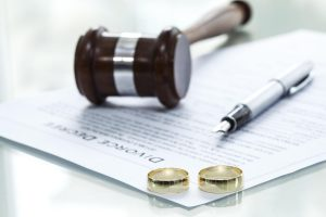 divorce document and wedding rings